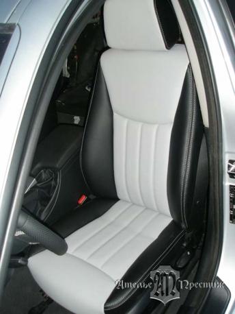 Перетяжка сидений и дверных вставок BMW (БМВ) 320 экокожа Hortica