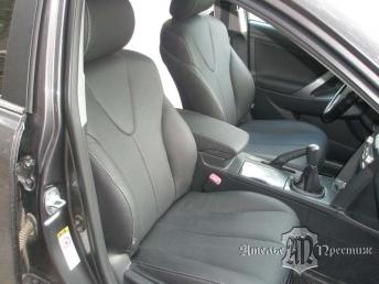 Перетяжка сидений и дверных вставок натуральной кожей Toyota Camry (Тойота Камри) 2010